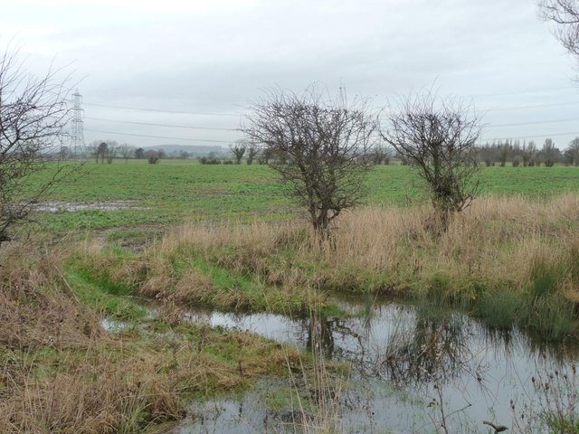 Issues flooding a field entrance, after much rain