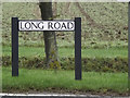 TL3857 : Long Road sign by Adrian Cable