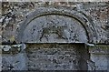 """SW9642 : Caerhays, St. Michael's Church: Weathered """"Agnus Dei"""" above the Norman north doorway by Michael Garlick"""