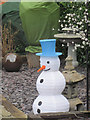 SP9111 : A Snowman in a garden in Miswell Lane, Tring by Chris Reynolds