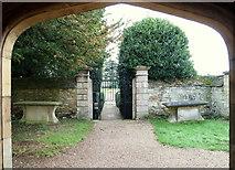 SK9239 : Belton House & Graveyard Gate, Belton, Lincs. by David Hallam-Jones