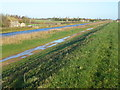 TL5192 : River, track and bank - The Ouse Washes near Welney by Richard Humphrey