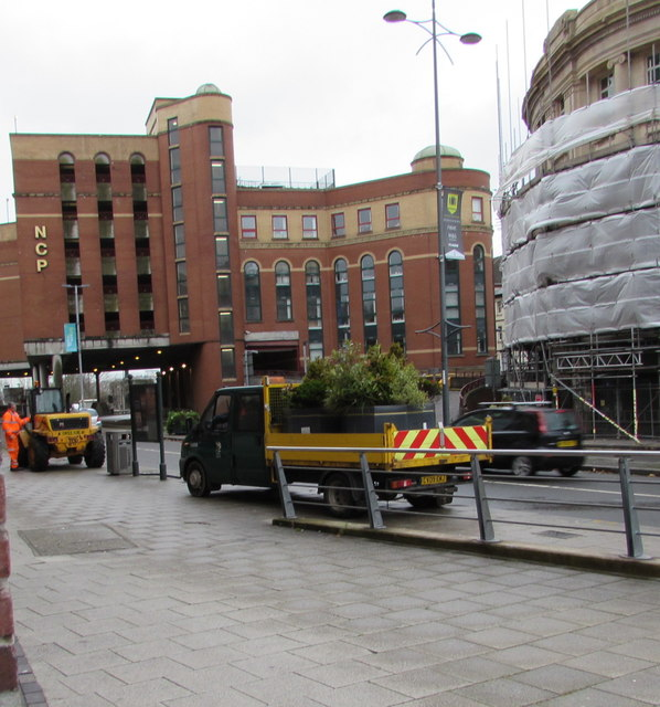 Potted shrubs in a council lorry, Queensway, Newport