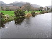 J3731 : The swollen Tullybranigan River in Islands Park by Eric Jones