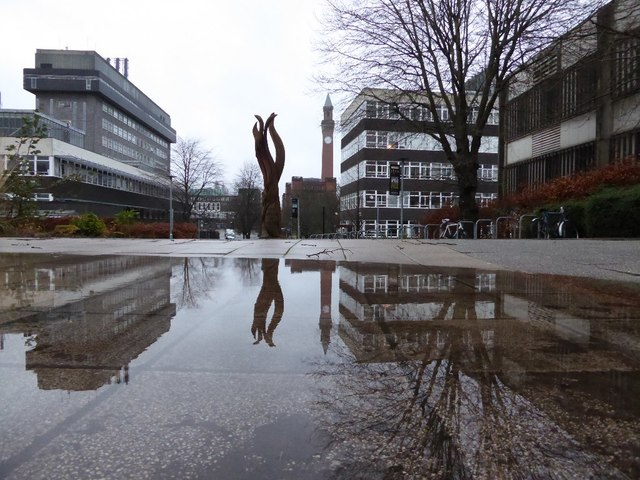 The University of Birmingham reflected in a puddle