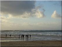 SW3526 : Figures on the beach on a sunny New Year's Eve by Rod Allday