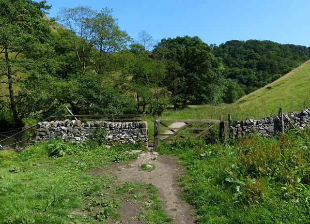 Dry stone wall and gate next to the River Dove