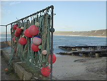 SW3526 : Fishing floats in Sennen harbour by Rod Allday
