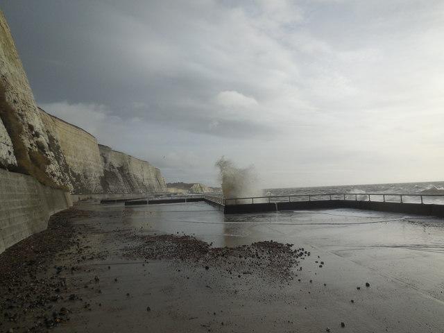 Waves breaking on Undercliff Walk by Paul Gillett