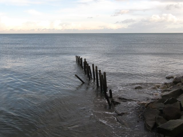 The remains of a groyne at the mouth of the Shimna River