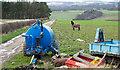 NZ2536 : Farm machinery beside farm road by Trevor Littlewood