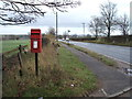 NZ2728 : Post box and bus stop on the A689 by JThomas