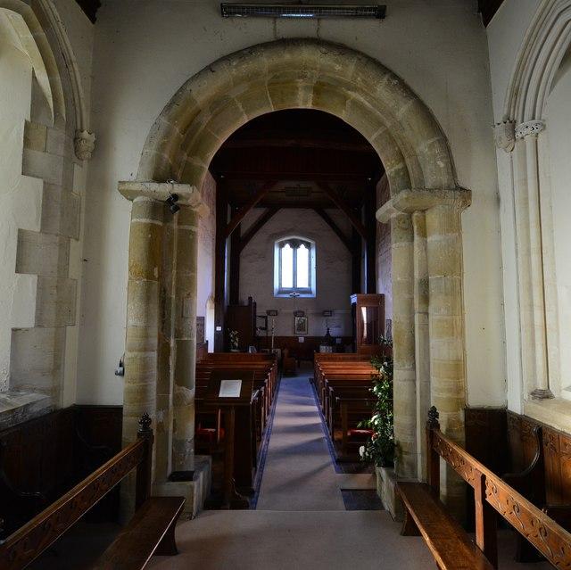Clayton; The Church of St. John the Baptist: Plain Norman chancel arch by Michael Garlick