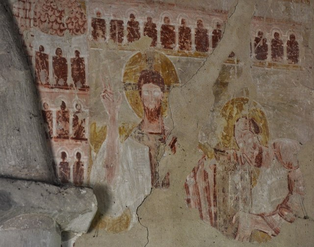 Clayton; The Church of St. John the Baptist: c12th painting to the right of the chancel arch by Michael Garlick