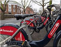 TQ3179 : Santander Cycles on Borough Road by David P Howard