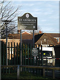 TL1314 : St.George's School sign by Adrian Cable