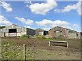 NZ1256 : Sheds at White Byerside farm by Robert Graham