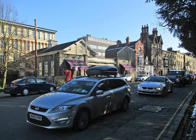 Trumpington Street: queuing traffic, Browns and winter sunlight