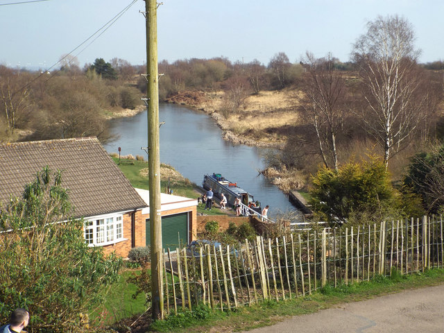 The canal basin below the dam, with boat, Chasewater country park