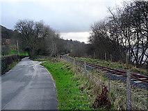 SH9234 : The B4403 road and the Bala Lake Railway by John Lucas