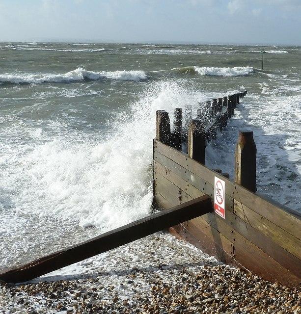 Waves break on the Groyne, West Wittering