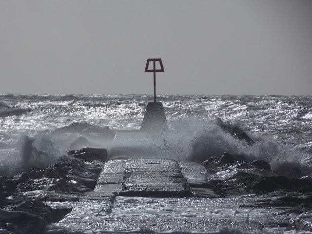 Hengistbury Head: waves breach the breakwater
