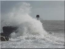 SZ1790 : Hengistbury Head: a breakwater is hit by a wave by Chris Downer