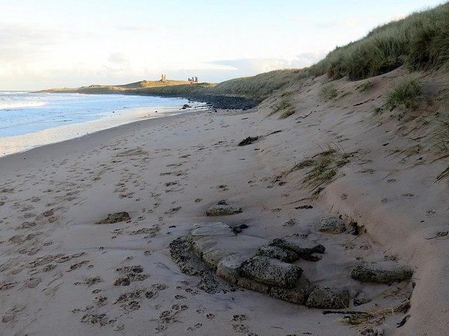 Base of concrete 'sandbag' pillbox, Embleton Bay