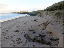 NU2422 : Base of concrete 'sandbag' pillbox, Embleton Bay by Andrew Curtis