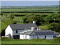 SS2321 : Houses and fields near Elmscott in Devon by Roger  Kidd