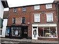 ST7814 : Shops in Market Cross, Sturminster Newton by David Smith