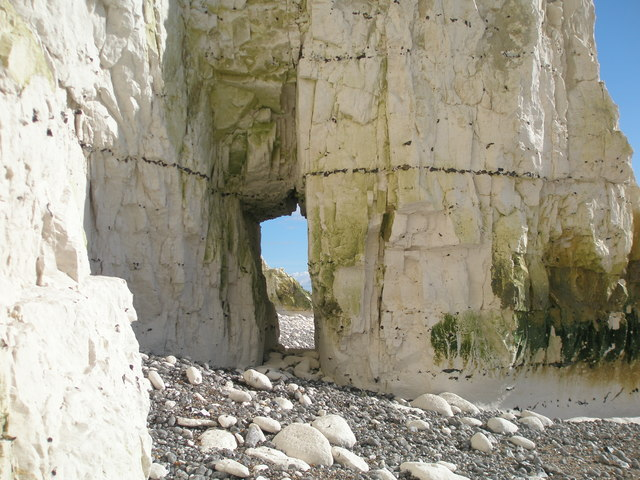 Natural arch below Rough Brow at the Seven Sisters, East Sussex