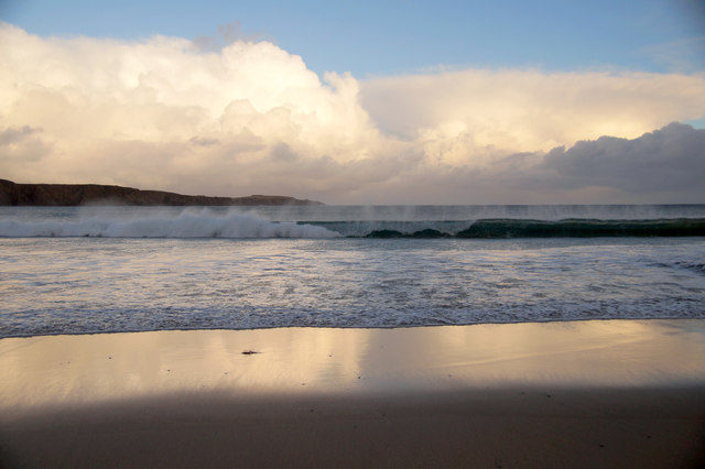 Clouds reflected on Norwick beach
