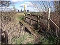 SK4728 : Footbridge over a field drain by Ian Calderwood
