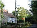 SE6481 : Street Lighting on a Utility Pole in Harome, North Yorkshire by Matthew Cotton