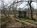 SK5656 : Wooden shelter in Harlow Wood by Graham Hogg