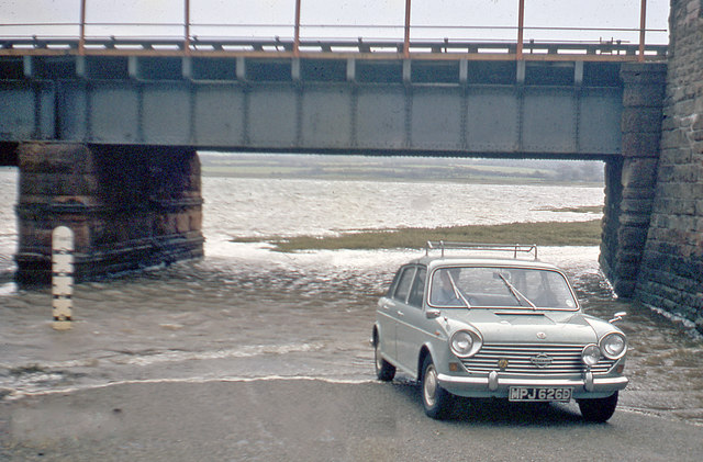 Driving through floods at site of Eskmeals station, 1966
