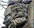 TG1602 : Carved stone head by Evelyn Simak