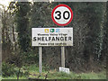 TM1084 : Shelfanger Village Name sign by Adrian Cable