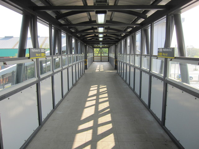 The modern footbridge at Hooton railway station