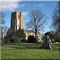TL5686 : Littleport: parish church and war memorial by John Sutton