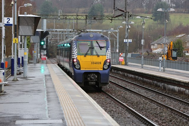 A Class 334 electric train departs Anniesland Train Station