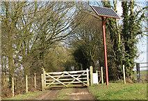 TG1408 : Solar panel beside the entrance to Algarsthorpe Farm by Evelyn Simak
