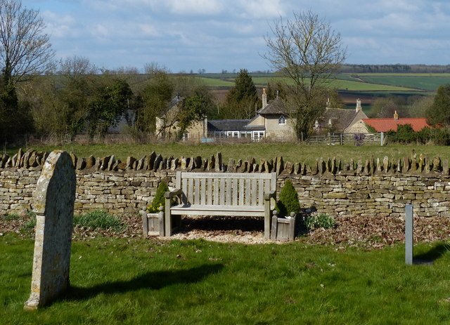 Seat in the churchyard of St John the Baptist