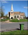 TL2842 : Steeple Morden: steeple and bin by John Sutton
