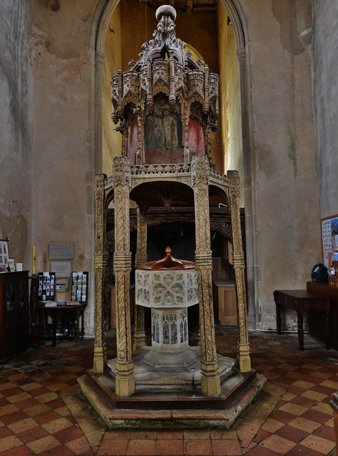 Trunch: St. Botolph's Church: The font (ca. 1350) and oak canopy (ca. 1500)