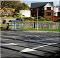 ST0996 : White arrows and blue bus shelter, Treharris by Jaggery