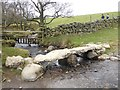 NY6927 : Clapper bridge over Great Rundale Beck by Oliver Dixon