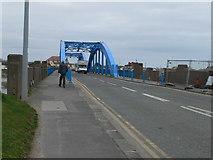 SH9980 : Approaching Foryd bridge from Rhyl by Eirian Evans