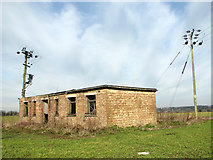 TG1507 : Disused building north of Watton Road by Evelyn Simak
